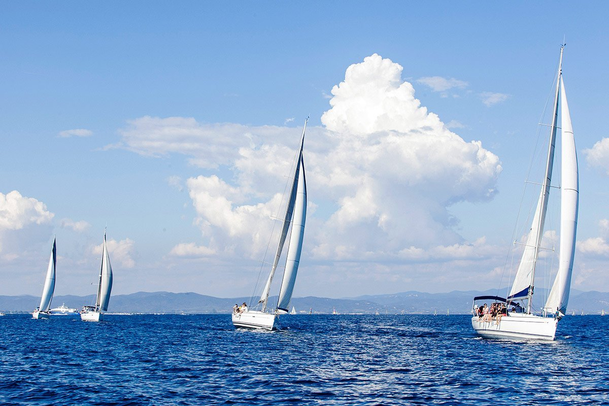 Boat sailing during a team building organized for Lapeyre Group on Porquerolles Island and photographed by Denis Dalmasso professionnal photographer in south if France
