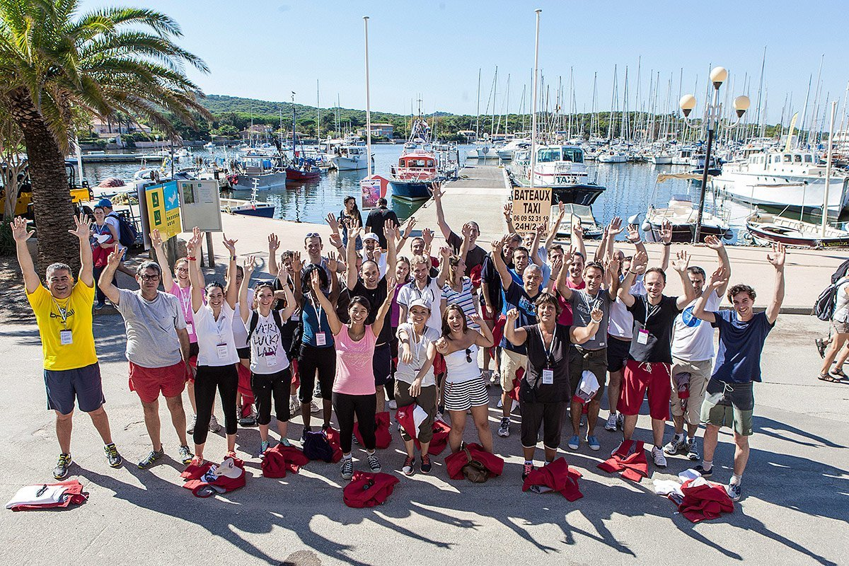 Team group on Porquerolles Island during a corporate seminar photographed by Denis Dalmasso